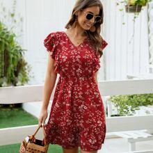 Kleid mit Blumen Muster und Band hinten