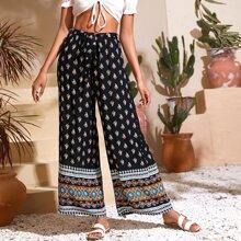 Pantalones con estampado tribal de pierna ancha de cintura con cordon