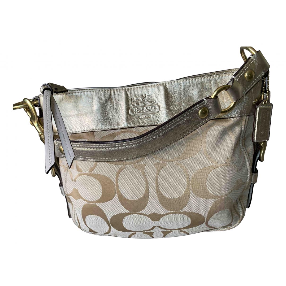 Coach \N Gold Cloth handbag for Women \N