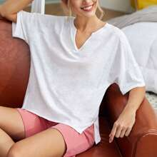 Camiseta unicolor bajo con abertura de cuello V