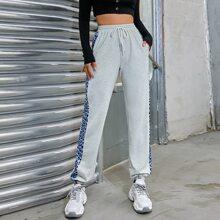 Pantalones de cintura con cordon con estampado de dibujo