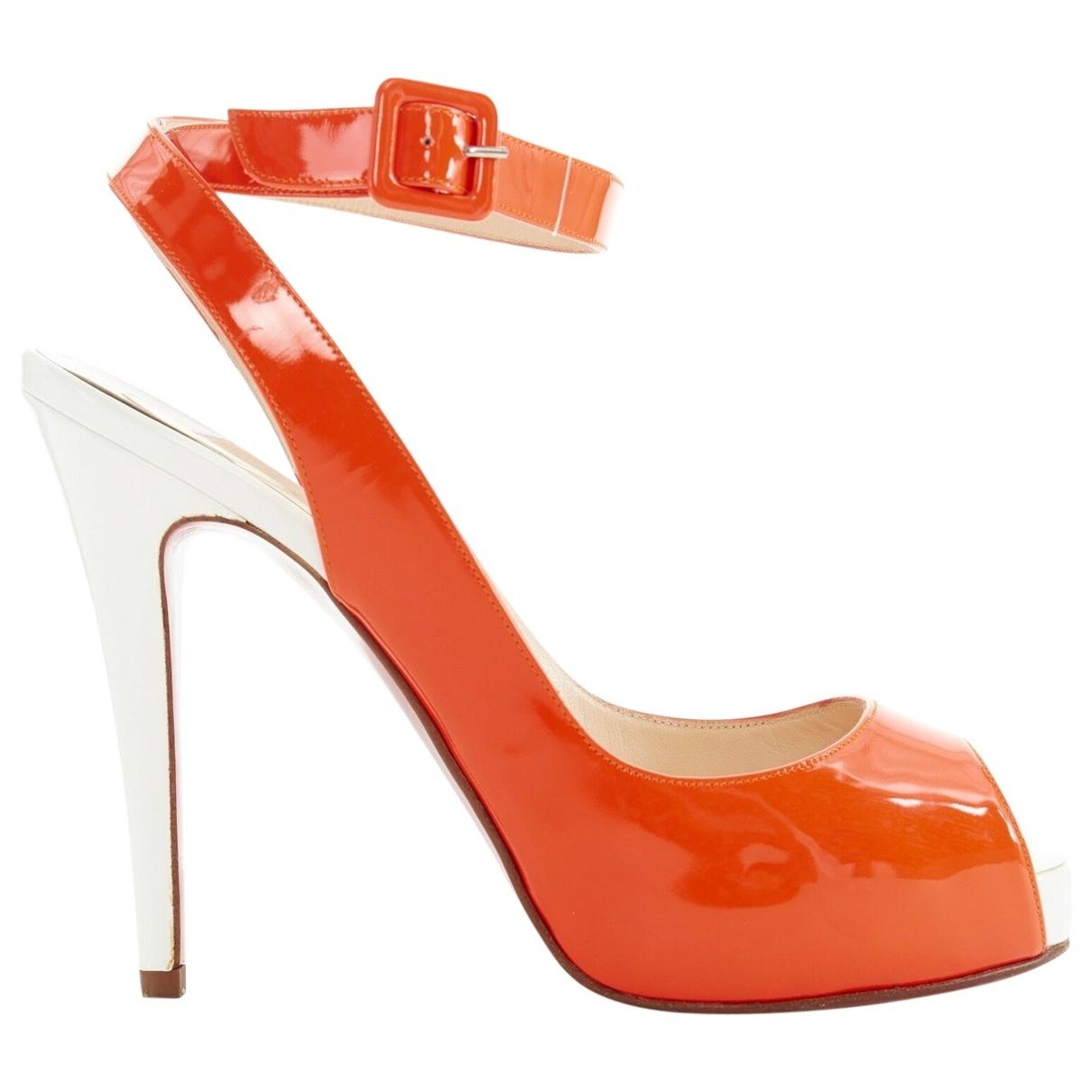 Christian Louboutin - Escarpins   pour femme en cuir verni - orange