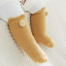 Baby Socken mit Pompons