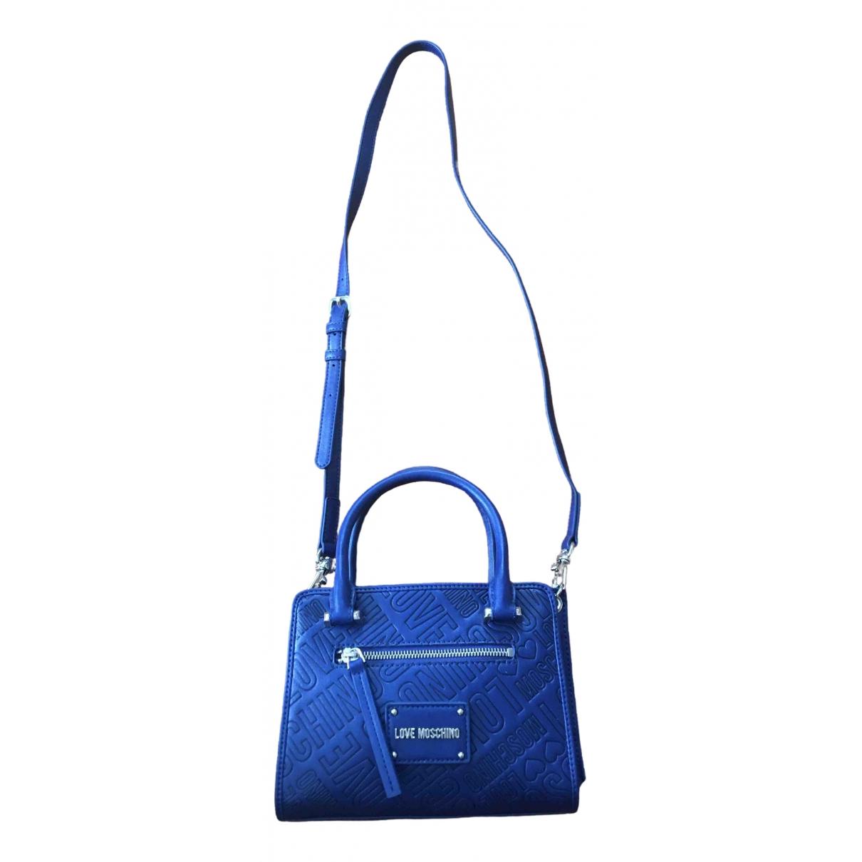 Moschino Love \N Clutch in  Blau Leder