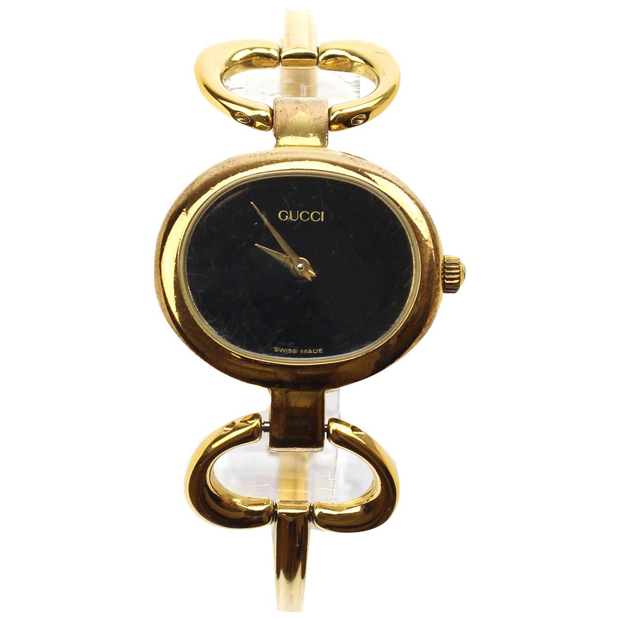 Gucci - Montre   pour femme en plaque or - noir