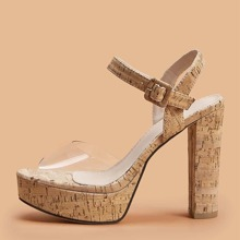 Transparente Sandalen mit klobiger Sohle und Knochelriemen