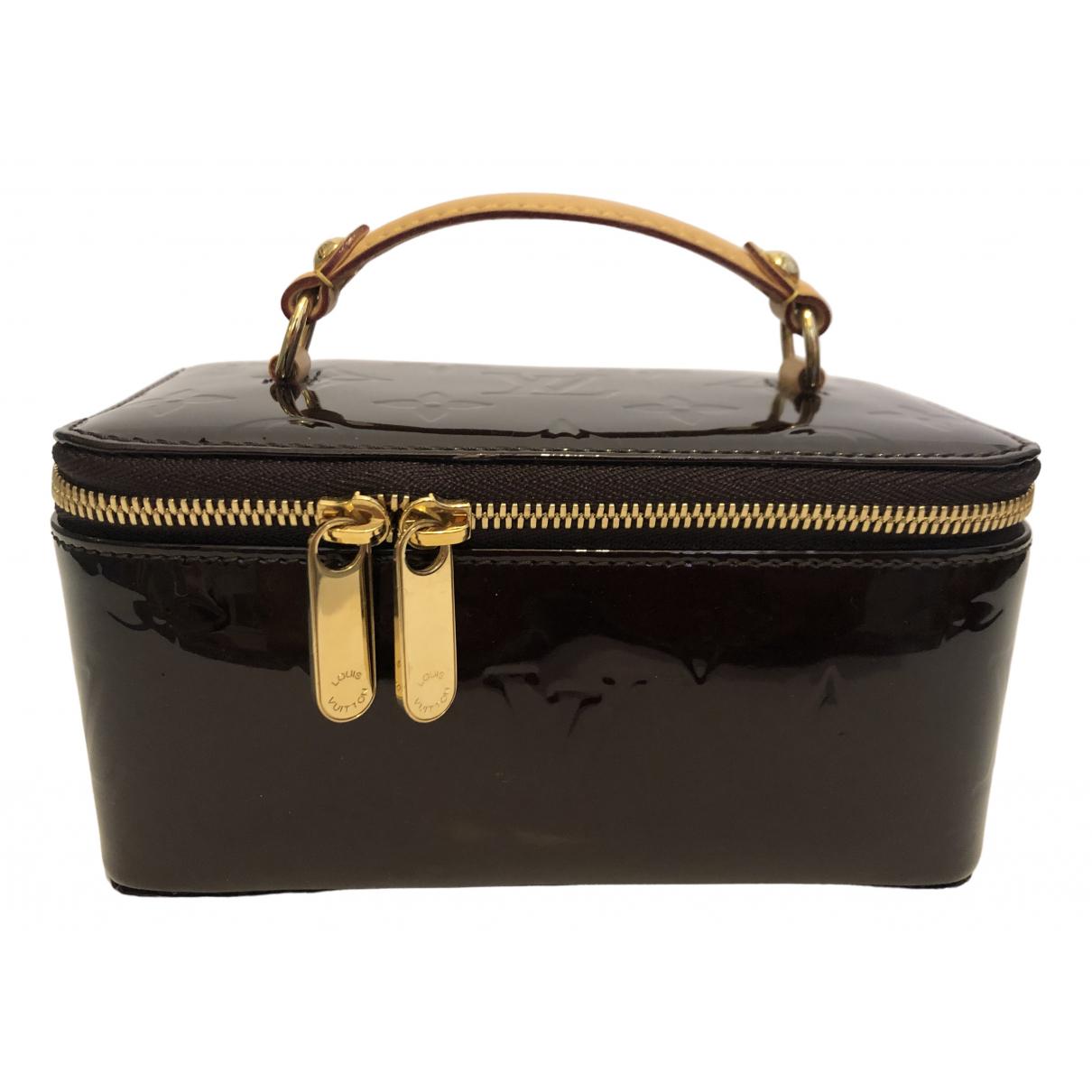 Louis Vuitton - Sac de voyage   pour femme en cuir verni - bordeaux