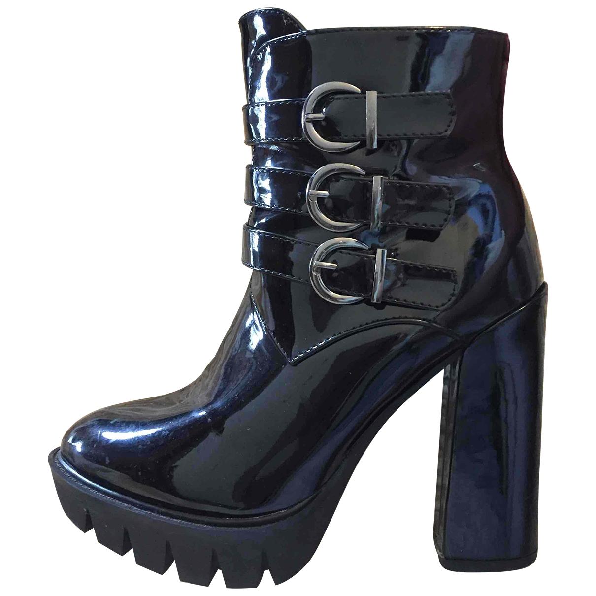 - Boots   pour femme en cuir verni - noir