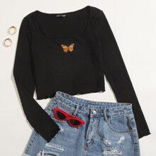 Camiseta corta con bordado de mariposa