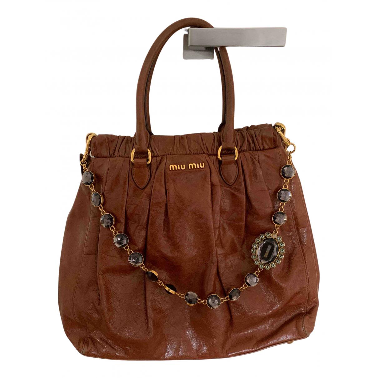Miu Miu Miu Crystal Handtasche in  Braun Leder