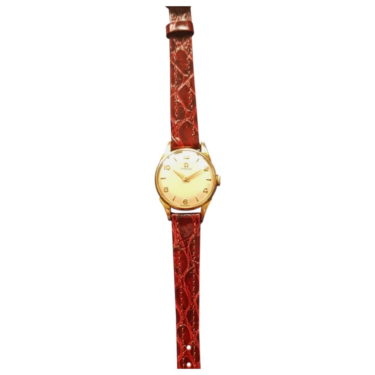 Omega \N Uhr in  Rot Gelbgold