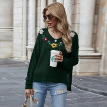 Pullover mit Blumen Stickereien und Schlitz am Saum