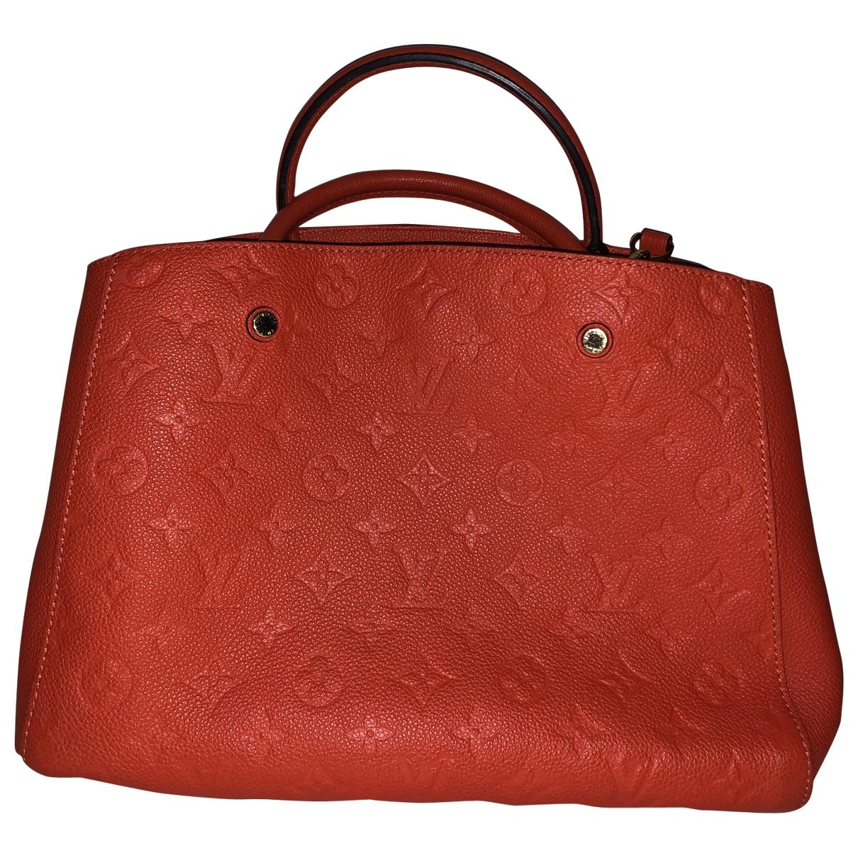 Louis Vuitton Montaigne Orange Leather handbag for Women \N