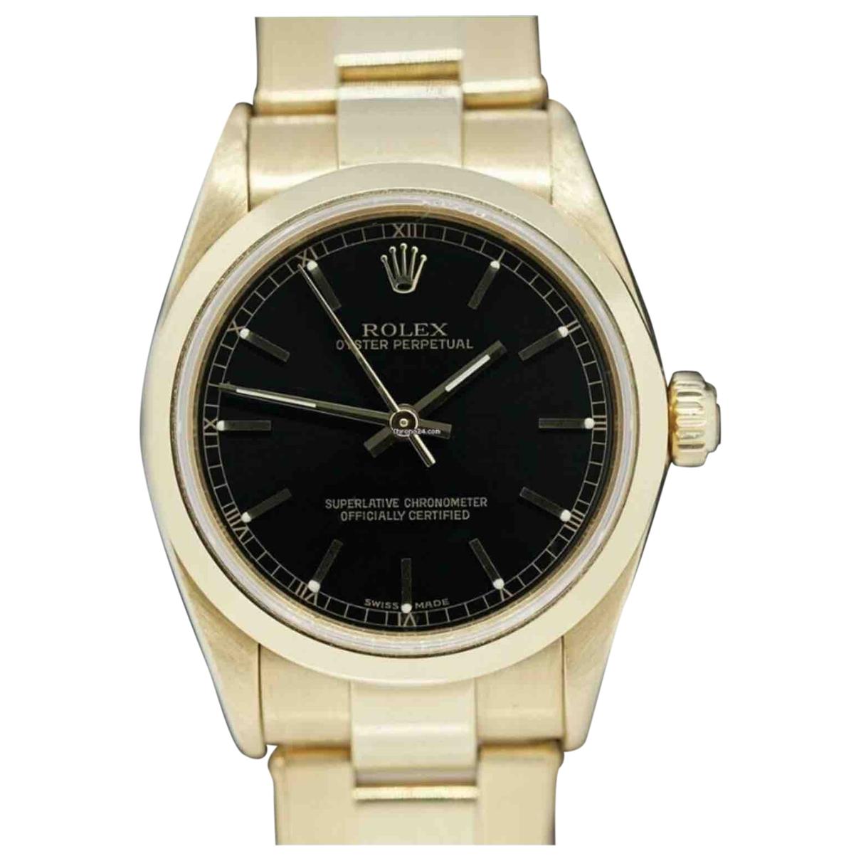 Rolex Oyster Perpetual 31mm Uhr in  Schwarz Gelbgold