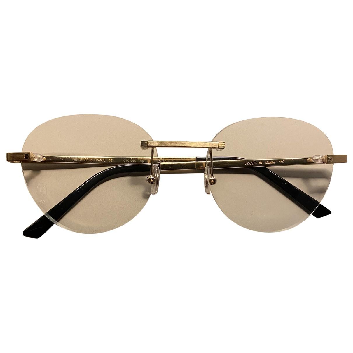 Cartier \N Sonnenbrillen in  Gold Metall
