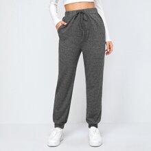 Pantalones unicolores de cintura con cordon