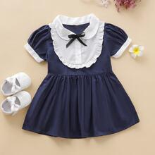 Baby Maedchen A Linie Kleid mit Kontrast Einsatz und Rueschenbesatz