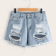 Shorts denim rotos bajo crudo
