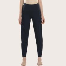 Einfarbige Sports Hose mit seitlichem Reissverschluss