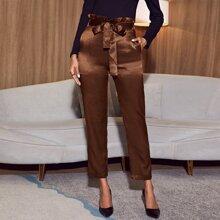 Pantalones de saten con cinturon de cintura con volante