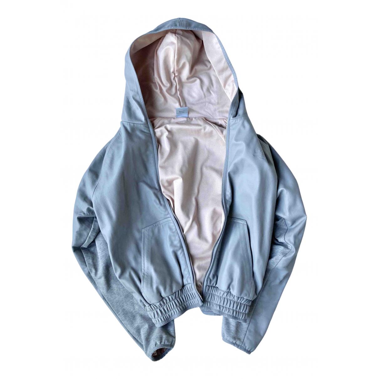 Nike - Veste   pour femme en cuir - gris