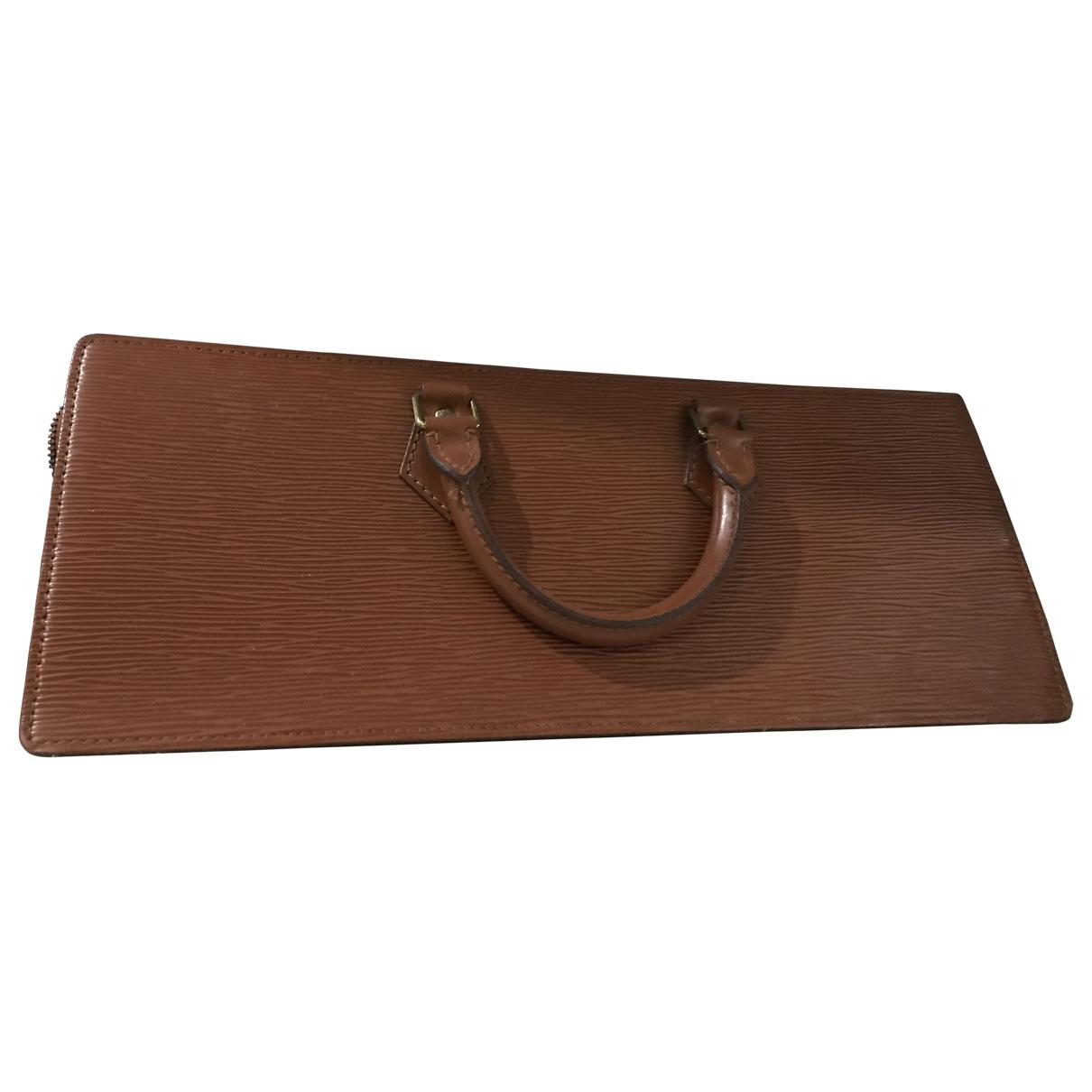 Louis Vuitton - Sac a main Triangle pour femme en cuir - marron