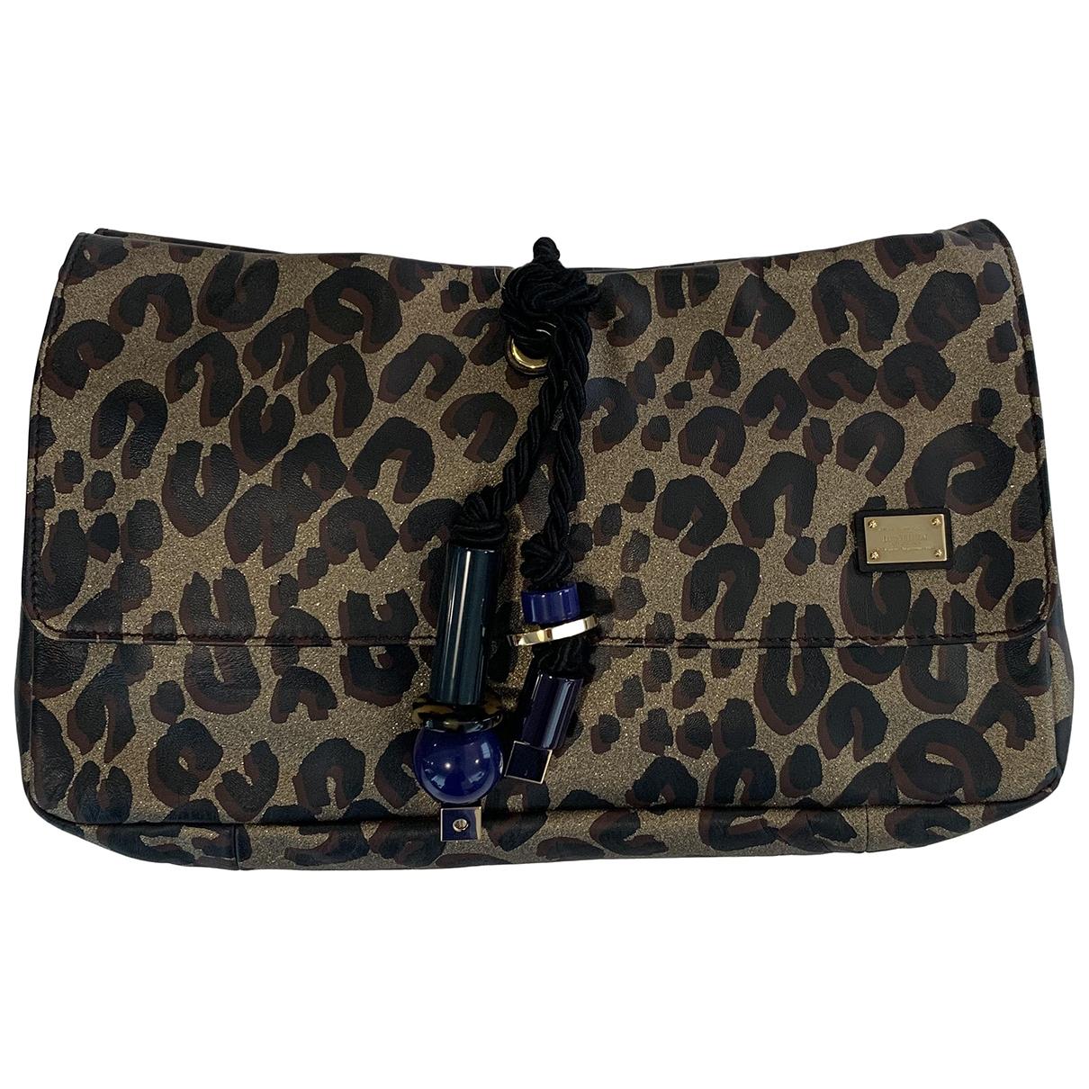 Louis Vuitton - Pochette   pour femme en cuir - dore