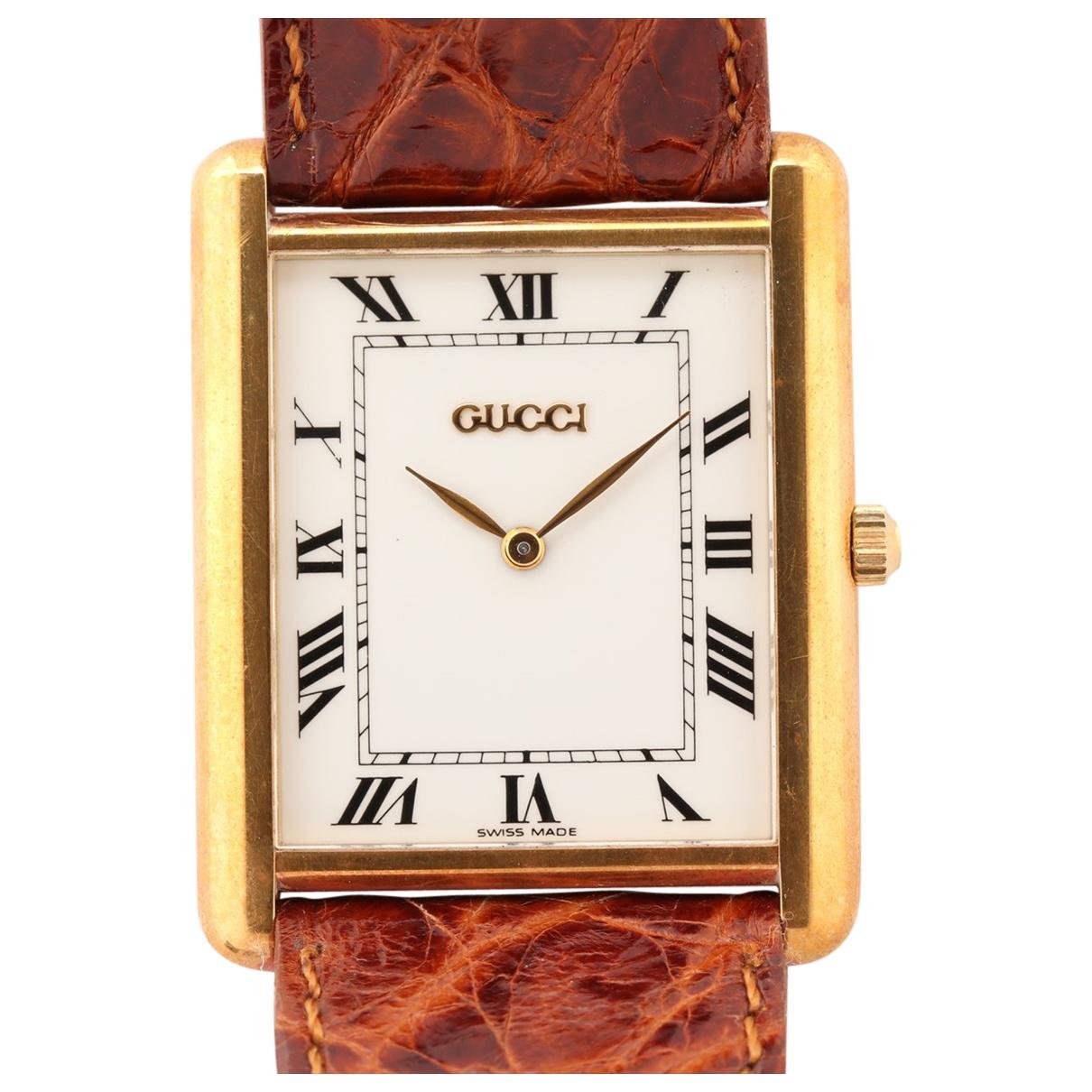 Gucci - Montre   pour femme en plaque or