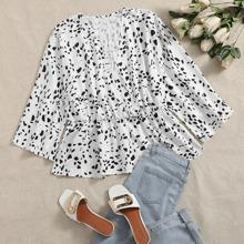 Bluse mit V Ausschnitt vorn, Muster und Schosschen