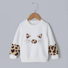 Sweatshirt mit Kontrast Kunstpelz und Karikatur Stickereien