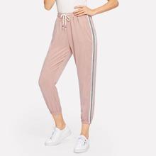 Pantalones con bandas laterales de rayas