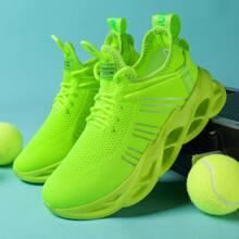 Neon gruene Sneakers mit Band Dekor und klobiger Sohle
