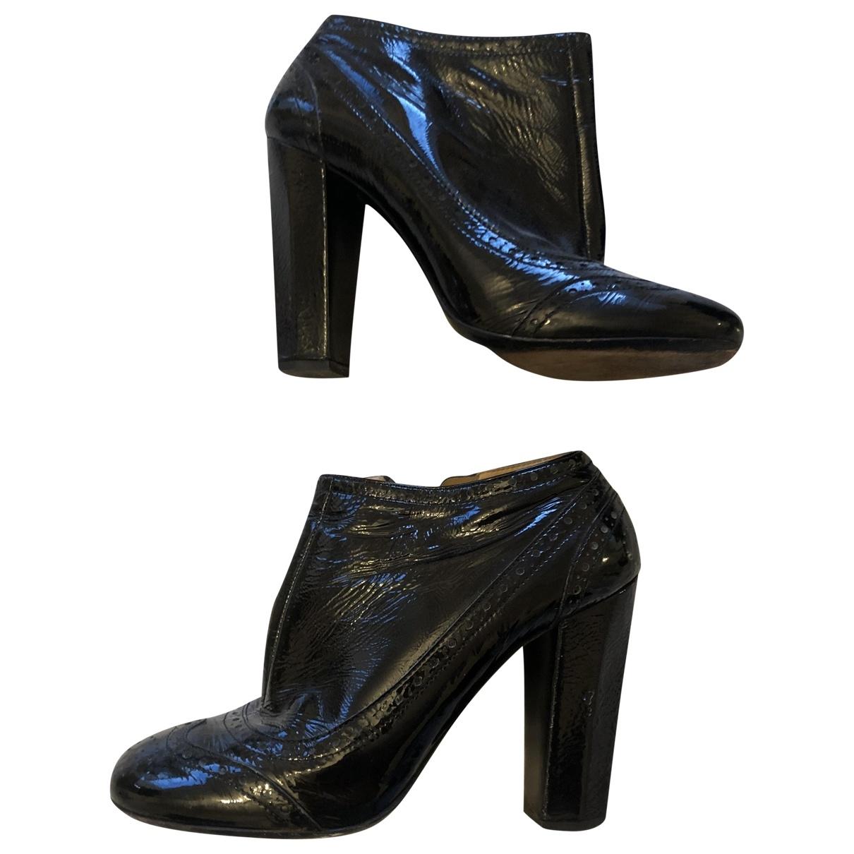 Miu Miu - Boots   pour femme en cuir verni - noir