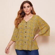 Camisa escote V con estampado floral de margarita