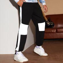 Pantalones deportivos de cintura con cordon panel reflexivo