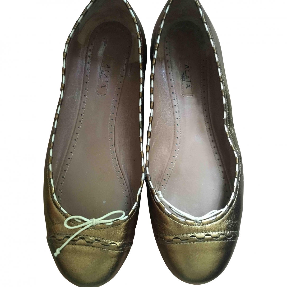Alaïa \N Gold Leather Ballet flats for Women 36 EU