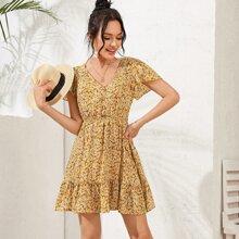 Kleid mit Knopfen vorn, Raffungsaum und Bluemchen Muster