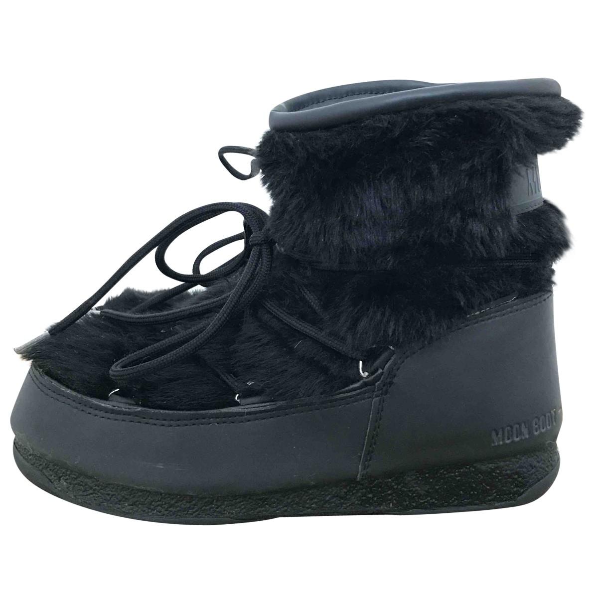 Moon Boot - Bottes   pour femme en fourrure synthetique - noir