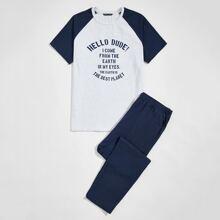Schlafanzug Set mit Buchstaben Grafik und schraegen Taschen vorn