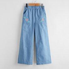 Pantalones con bolsillo oblicuo con bordado floral