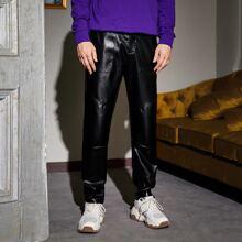 Pantalones de cuero sintetico con diseño de tuberia