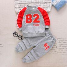 Sudadera de manga raglan con estampado de letra con pantalones deportivos
