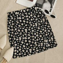 Falda bajo con abertura floral de margarita