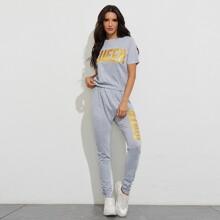 T-Shirt mit Buchstaben Grafik und Jogginghose mit Streifen