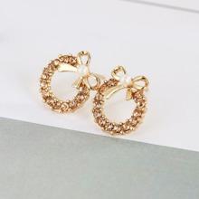 Pendientes de aro con diamante de imitacion con diseño de lazo