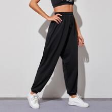 Pantalones deportivos de cintura alta unicolor