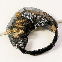Diadema con malla con flor