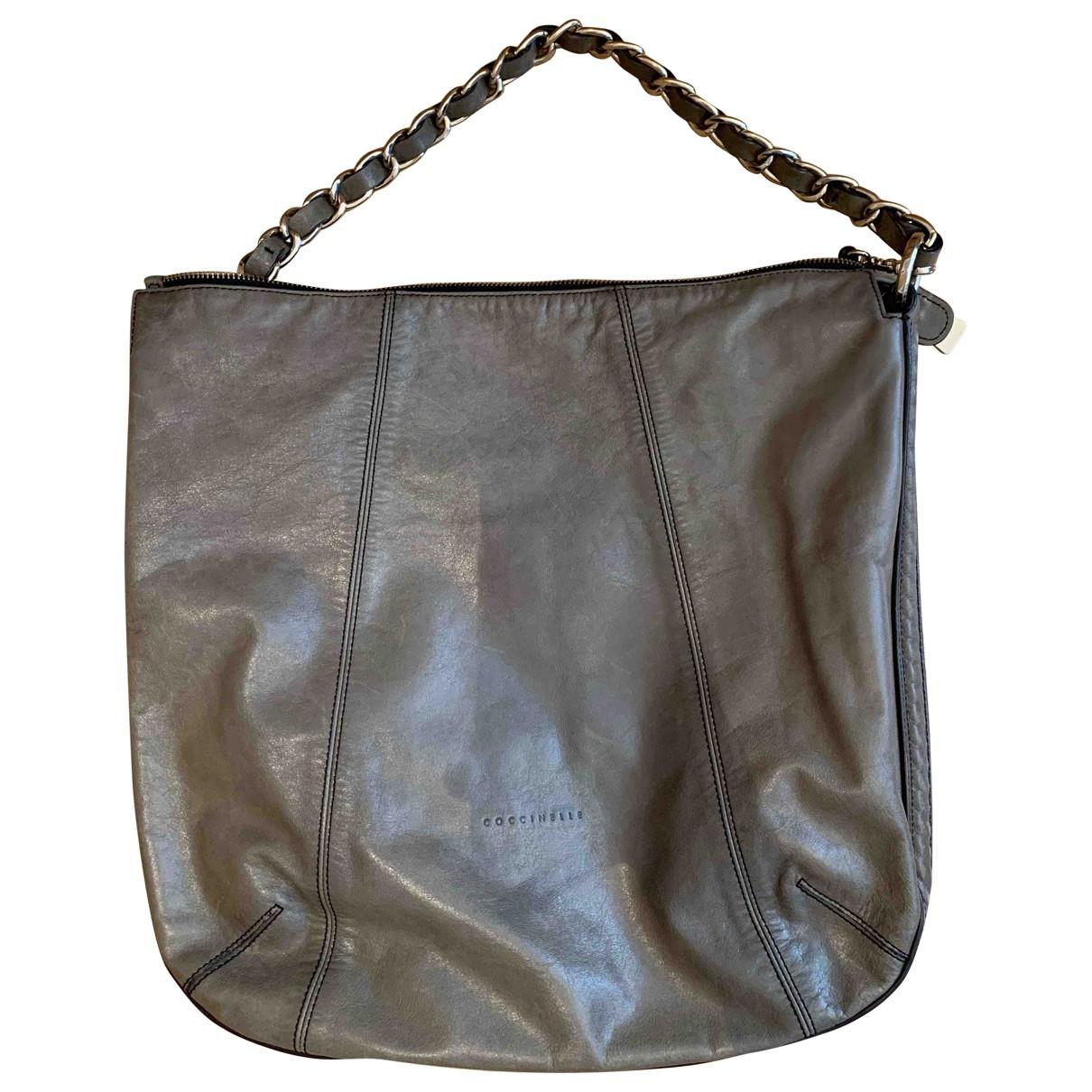 Coccinelle \N Handtasche in  Khaki Leder