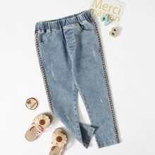 Jeans mit Band und Riss