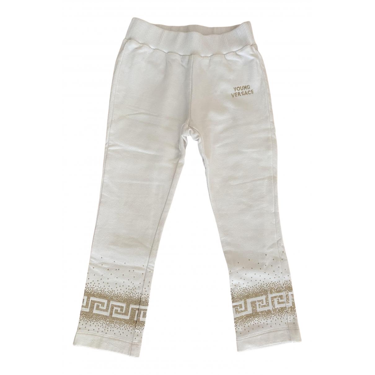 Pantalones en Algodon Crudo Versace